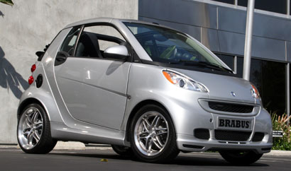 A three-quarter front view of a silver 2009 smart fortwo brabus cabriolet