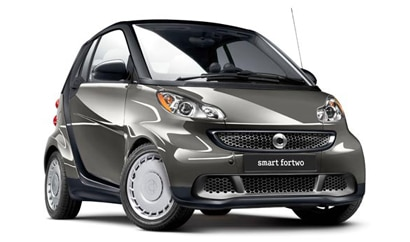 A three-quarter front view of a 2013 smart fortwo pure coupe