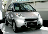 A three-quarter front view of a gray 2008 smart fortwo passion coupe