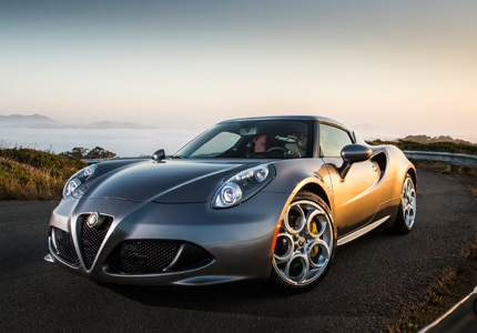 A three-quarter front view of the Alpha Romeo 4c, previously one of GAYOT's Top 10 Sports Coupes