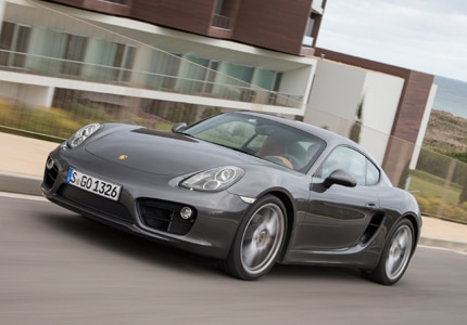 A three-quarter front view of the Porsche Cayman, one of GAYOT's Top 10 Sports Coupes