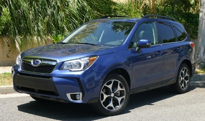 A three-quarter front view of the 2014 Subaru Forester 2.0XT Touring