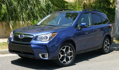 A three-quarter front view of the 2014 Subaru Forester 2.0XT