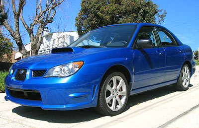 A three-quarter front view of a blue 2006 Subaru Impreza WRX TR