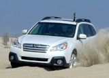 A 2013 Subaru Outback 2.5i Limited in action on the beaches of North Carolina's Outer Banks