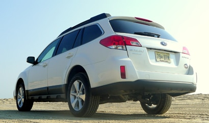 A three-quarter rear view of a 2013 Subaru Outback