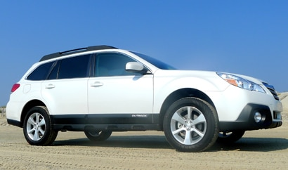 A side view of a white 2013 Subaru Outback