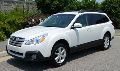 A three-quarter front view of a 2013 Subaru Outback 2.5i Limited