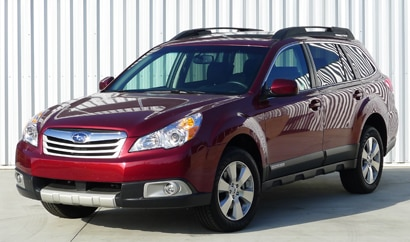 A three-quarter front view of a red 2012 Subaru Outback 3.6R Limited