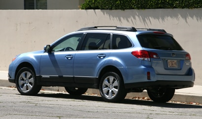 A three-quarter rear view of a 2010 Subaru Outback 2.5i Limited
