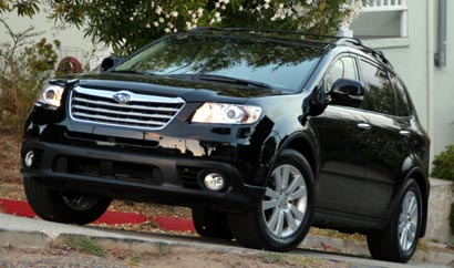 A three-quarter front view of a black 2008 Subaru Tribeca Limited