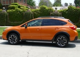 A side view of a 2013 Subaru XV Crosstrek 2.0i Limited