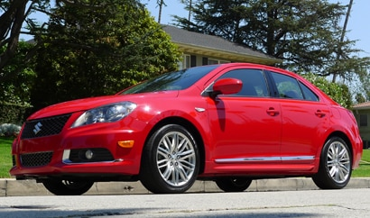 A three-quarter front view of a red 2012 Suzuki Kizashi Sport GTS