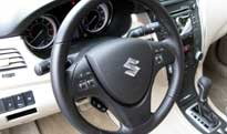 A steering wheel and interior dash view of the 2010 Suzuki Kizashi