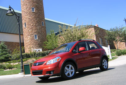 A three-quarter front view of a red 2007 Suzuki SX4