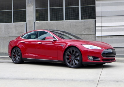 A three-quarter front view of a Tesla Model S electric sedan