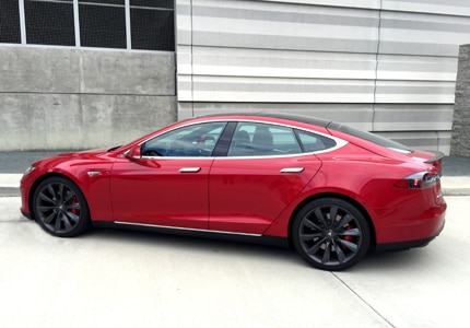 A three-quarter rear view of the 2016 Tesla Model S P90D Ludicrous fastback