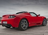 A three-quarter rear view of a Tesla Roadster