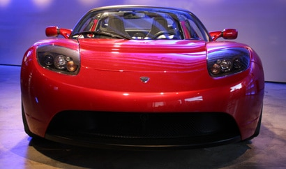 A front view of a red 2008 Tesla Roadster at Tesla Motor's store in Los Angeles