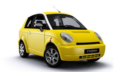 A three-quarter front view of a yellow 2011 THINK City