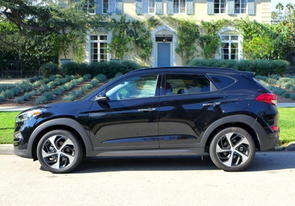A side view of the Hyundai Tuscon, one of GAYOT's Top 10 Small SUVs