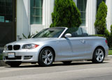 A three-quarter front view of a gray 2008 BMW 128i Convertible