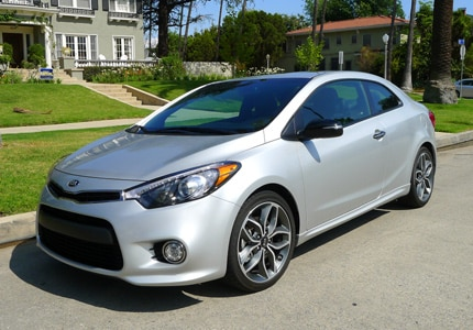 A three-quarter front view of the 2015 Kia Forte Koup SX