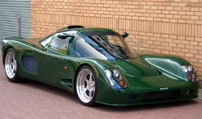 A three-quarter front view of a green Ultima GTR