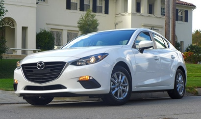 A three-quarter front view of the 2014 Mazda 3, one of GAYOT's Top 10 Value Cars