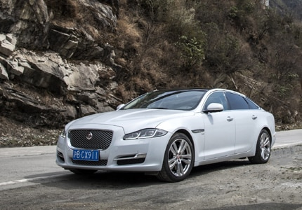 A three-quarter front view of the 2016 redesigned Jaguar XJ