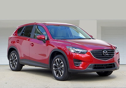 A three-quarter front view of a 2016 Mazda CX-5 SUV, one of GAYOT's Top 10 Value Cars