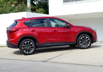 A three-quarter rear view of a 2016 Mazda CX-5 Grand Touring FWD SUV