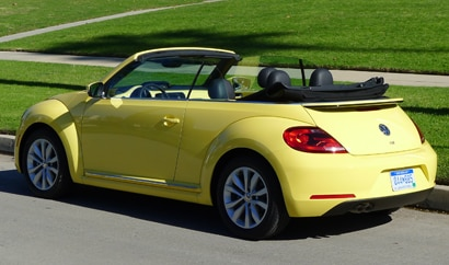 A three-quarter rear view of a Volkswagen Beetle TDI Convertible