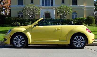 A three-quarter front view of a 2013 Volkswagen Beetle TDI Convertible