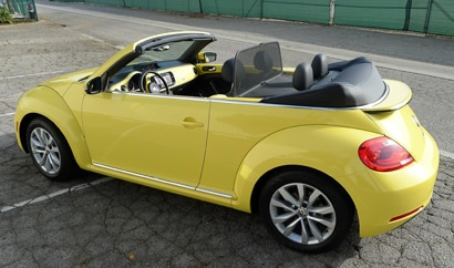 A three-quarter rear view of a 2013 Volkswagen Beetle TDI Convertible