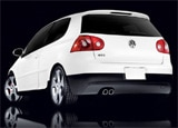 A three-quarter rear view of a white 2009 Volkswagen GTI