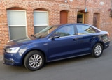 A three-quarter front view of a 2013 Volkswagen Jetta Hybrid SE