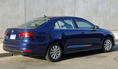 A three-quarter rear view of a 2013 Volkswagen Jetta Hybrid