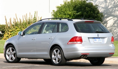 A three-quarter rear view of a silver 2009 Volkswagen Jetta SportWagen SE