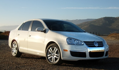 A three-quarter front view of a white 2009 Volkswagen Jetta TDI