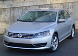 A three-quarter front view of a 2013 Volkswagen Passat TDI