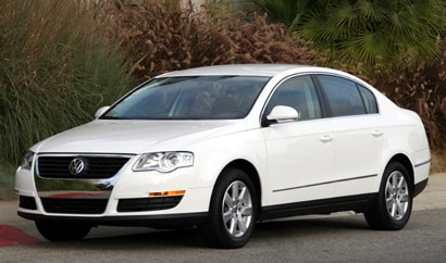 A three-quarter front view of a white 2008 Volkswagen Passat Turbo