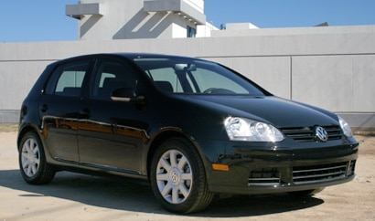 A three-quarter view of a black 2006 Volkswagen Rabbit