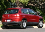 A three-quarter rear view of a red 2009 Volkswagen Tiguan, one of our Top 10 Small SUVs