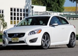 A three-quarter front view of a white 2011 Volvo C30 R-Design