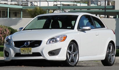A three-quarter front view of a white 2010 Volvo C30 R-Design