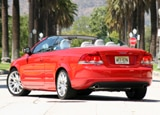 A three-quarter rear view of a red 2008 Volvo C70 T5