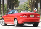 A three-quarter rear view of a red 2008 Volvo C70