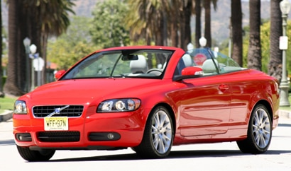 A three-quarter front view of a red 2008 Volvo C70 T5 convertible