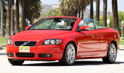 A three-quarter front view of a red 2008 Volvo C70 T5